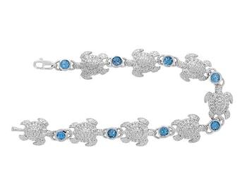 Sterling Silver turtle bracelet with swiss blue topaz stones. sea life jewelry, nautical jewelry.