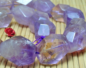 A grade 15 inches of Natural Amethyst Faceted nugget beads in 12-14mmx19-21mm length