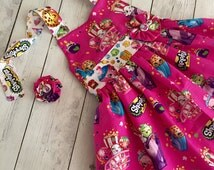 Shopkins dress with removable dress pin. Shopkins birthday.Birthday dress. Lippy. Cheeky. Strawberry. D'lish. Chee zee. Kooky.