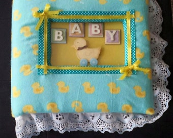 Homemade, personalized baby photo books
