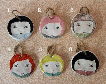 Ceramic Girl Face Wall Hangings. Hanging Hatties. Winter Knits. 6 styles. Hand drawn and unique.
