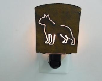 Pit Bull nightlight image cut into rusted sheet metal