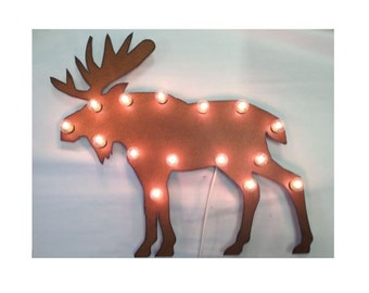 Moose marquee made out of rusted metal lighted sign