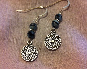 Sterling silver and blue/black cats eye bead earrings with celtic knots on circle charms.