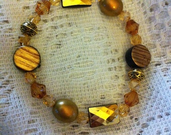 Topaz and gold beaded bracelet with Celtic knot beads.