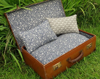 A quirky pet bed, made from a vintage 1940s suitcase.  For pets with a taste for vintage.  Cat bed. Small dog bed.