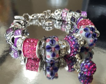 Pink and purple beaded bracelet.