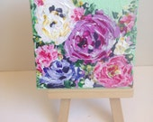 mini painting with easel,  pink roses and minty green background.