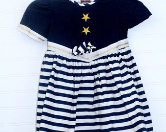 Vintage girls sailor dress, navy blue with with white stripes and Gold star trim detailing and trim, no name sz 3T