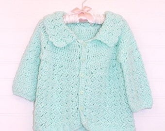Vintage baby sweater, green knit with five buttons up the front, size about 12 mo
