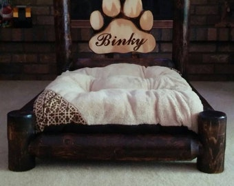 Cedar log dog bed with name to be added in paw.