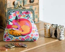 Coin purse made with 'Fox Nap' cotton print by Tula Pink in sorbet colour with a turquoise lining & hand stitched bronze colour metal frame