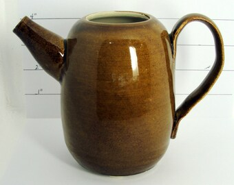 Footed brown pitcher