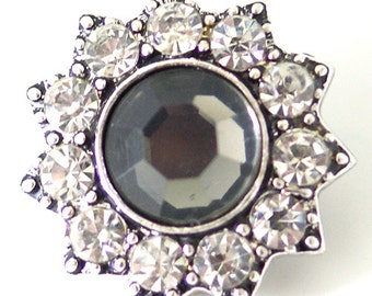 KB7111  3D Black Faceted Center Surrounded by Clear Crystals