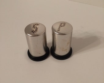 Vintage 1950's pink aluminum salt and pepper shakers