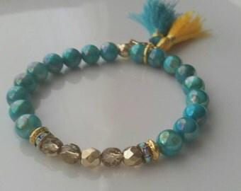 Aqua Wonders - Shell Glass Beads with Gold Czech crystals.