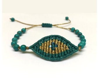 Green eye bracelet with natural turquoise beads
