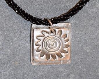 Small Fine Silver Square With a Sun Design on Cotton Choker