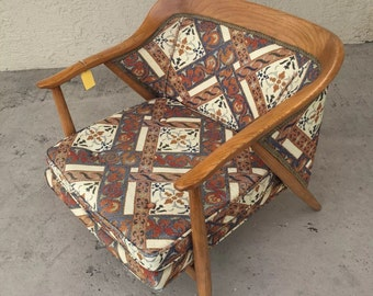 Mcm sculpted wood lounge chair.