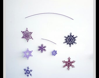 Snowflake mobile, tatted, purple/pink colors, tatting
