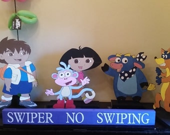 Dora the Explorer wooden cutouts, dora the explorer standees, dora backpack piñata, swiper no swiping sign