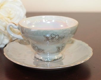 Pale Green Iridescent Teacup and Saucer – Gold Trim with Floral Outline – Japan