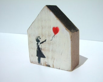 Casitas wood (wood house) Banksy