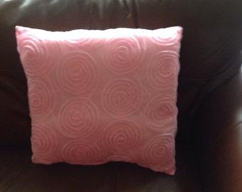 Pink swirl cushion