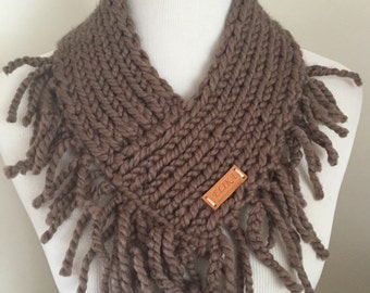 Knitted neck warmer in color Taupe with fringe.  Exclusive design.
