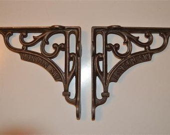 "A pair of 6"" antique style London SW1 cast iron shelf brackets"