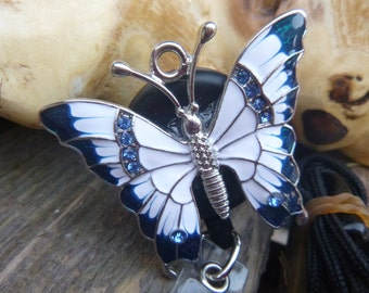 Retractable ID badge holder with butterfly and lanyard