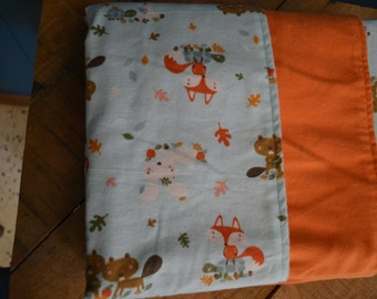 Woodland creatures Gender Neutral baby blanket foxes and squirrels blue and orange