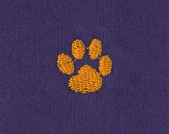 Embroidered tiger paw on purple Corduroy from Fabric Finders, tiger paw fabric by the yard for sewing and sport apparel,orange paw on purple