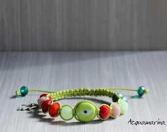 Macrame bracelet with colored green cotton yarn, gemstones, hand of Fatima pendant. Handmade.