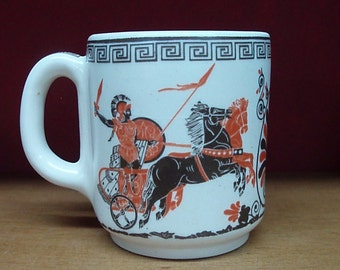 Handmade ceramis mug in white glaze, decorated with ancient greek chariots