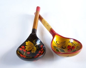 2 Khokhloma's spoons vintage Russian folk art lacquered wood black background and golden background vintage spoons