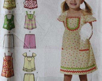 2008 UNCUT Sewing Pattern, SIMPLICITY 2909. Age 3-8. Girls Dresses, Tops, Shorts.