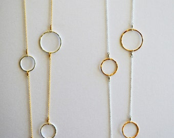 "Handmade hammered two-tone circle necklaces in silver and gold- 30"" long. Simple and elegant- a must for every wardrobe!"