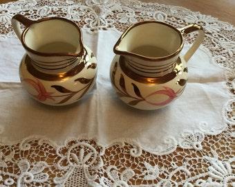 Grays copper lustre jugs
