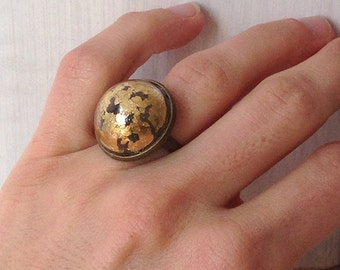 Ring with glass sphere and gold leaf