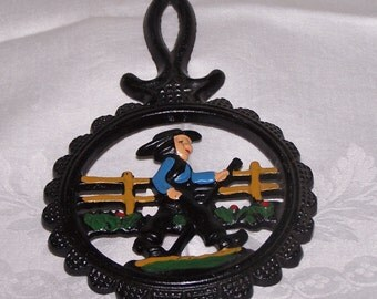 Dutch Trivet Cast Iron Male Amish Boy Open Motif