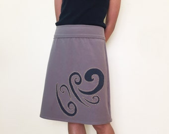 Jersey a line skirt, knee length,  jersey a line skirt, knit a line skirt, with hand stitched reverse applique swirl design