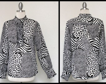 New Artsy Designer Animal Print , Banded Collar, Chic and Dressy Blouse for any season.Only One Available.