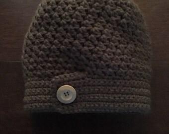 Ali hat in brown