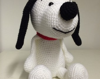 Hand made crochet Snoopy inspired black and white dog soft toy.