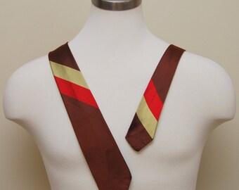 Vintage 1950s brown, yellow, red diagonal stripe all silk holeproof necktie
