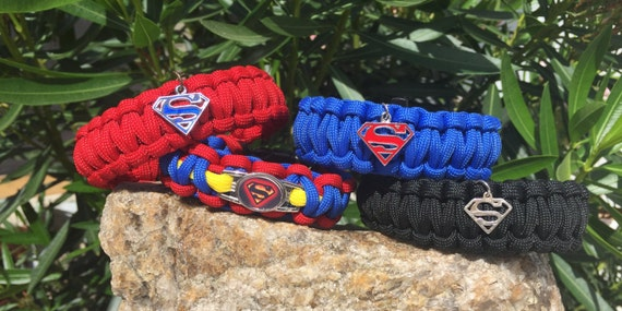 Superman Paracord Bracelet, handcrafted with 550 paracord , shoelace charm, and a whistle buckle