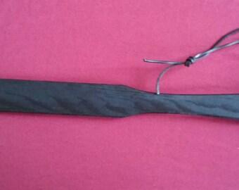 Black wooden paddle, 50 cm long