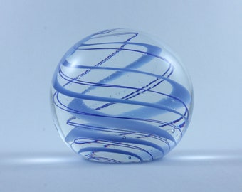Handmade glass paperweight with blue swirls
