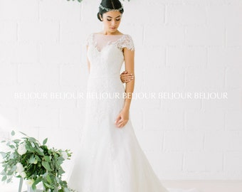 Glamorous bead work on guipure & french tulle, romantic illusion of sweetheart neckline, cap sleeves, daring v open back  semi fitted gown